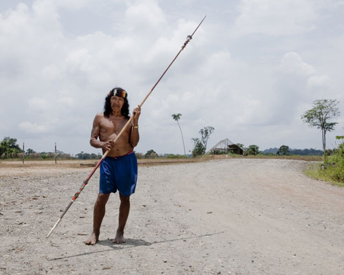 Davo Enomenga of the Waorani tribe in Yasuní, Ecuador. holding a spear.
